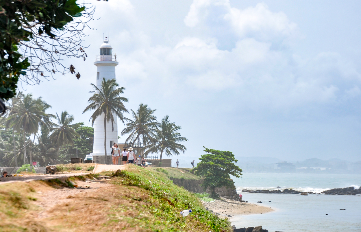 lighthouse on a sandy beach